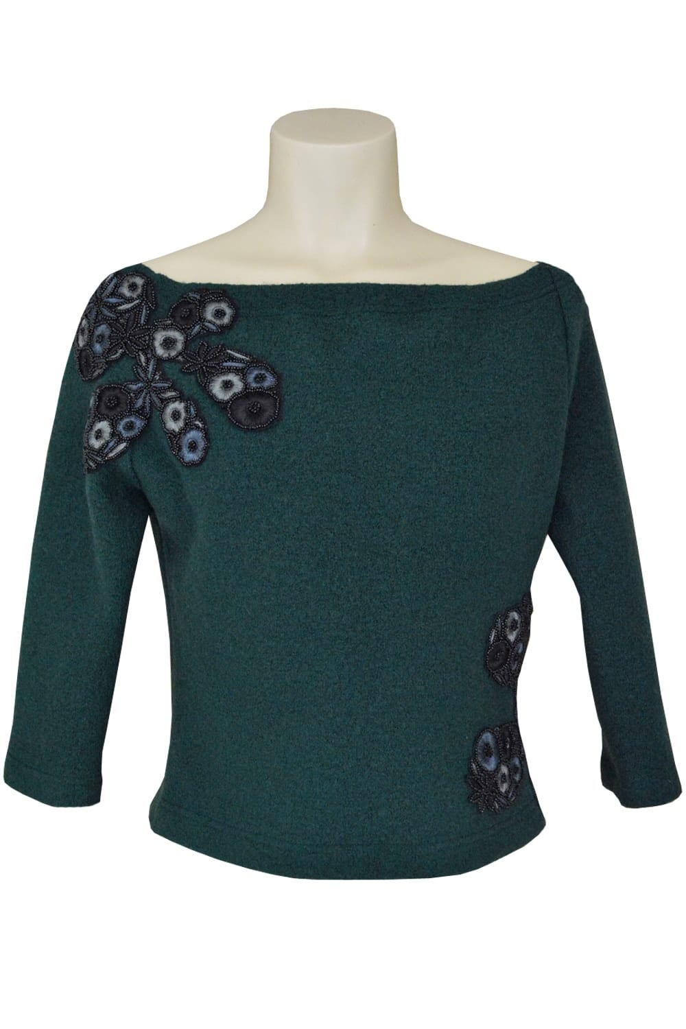 Boiled wool sweater neckline on the shoulders embellished with 4 patterns of hand embroidered black embroidery.