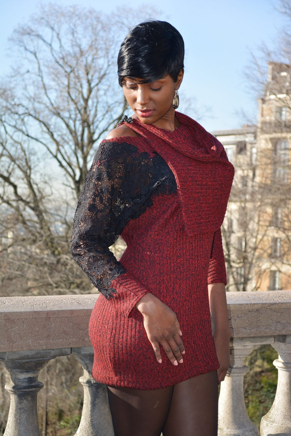 Fashion Paris. New fall winter collection by the fashion designer Erik Schaix Paris. Nice red dress with sleeve lace.