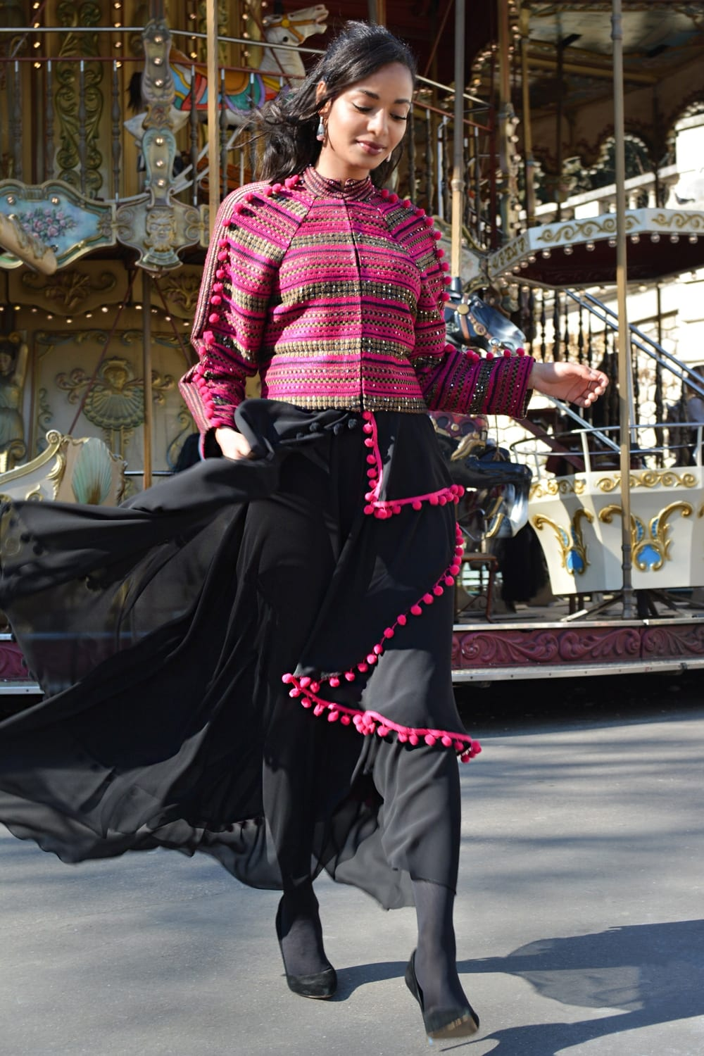 Fashion Paris. Long black skirt and pink jacket by Erik Schaix fashion designer Paris.