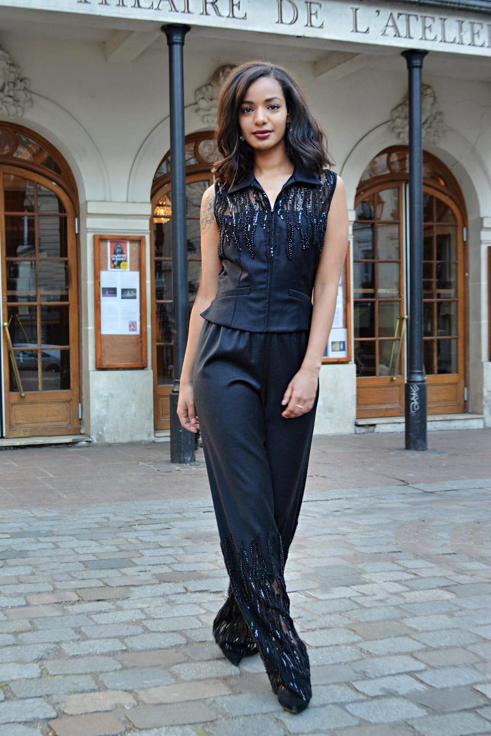 Trousers vest set. Sleeveless vest with side seam pockets and zip closure. Shoulders and trousers in transparency decorated with sequined embroidery and black pearls.