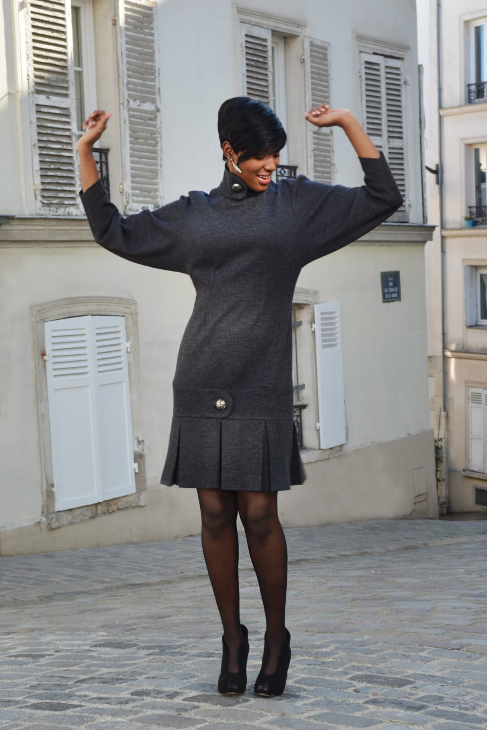 Fashion Paris. Gray wool dress. Long sleeves with crossed collar closed by a big silver button. Erik Schaix fashion designer Paris.