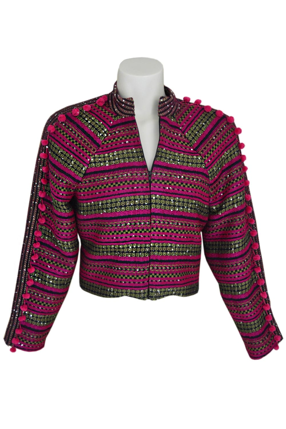 Tweed jacket embroidered. Closed on the front by a zip. Raglan sleeves decorated with small pink pompoms.