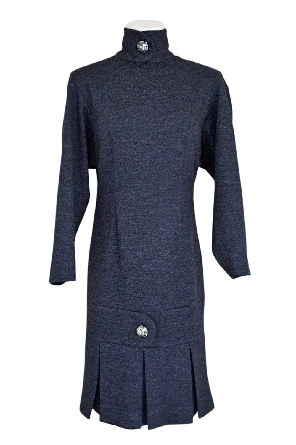 Gray wool dress. Long sleeves with crossed collar closed by a big silver button. Hollow pleats on the bottom of dress with closed cross belt with a silvery decorative button.