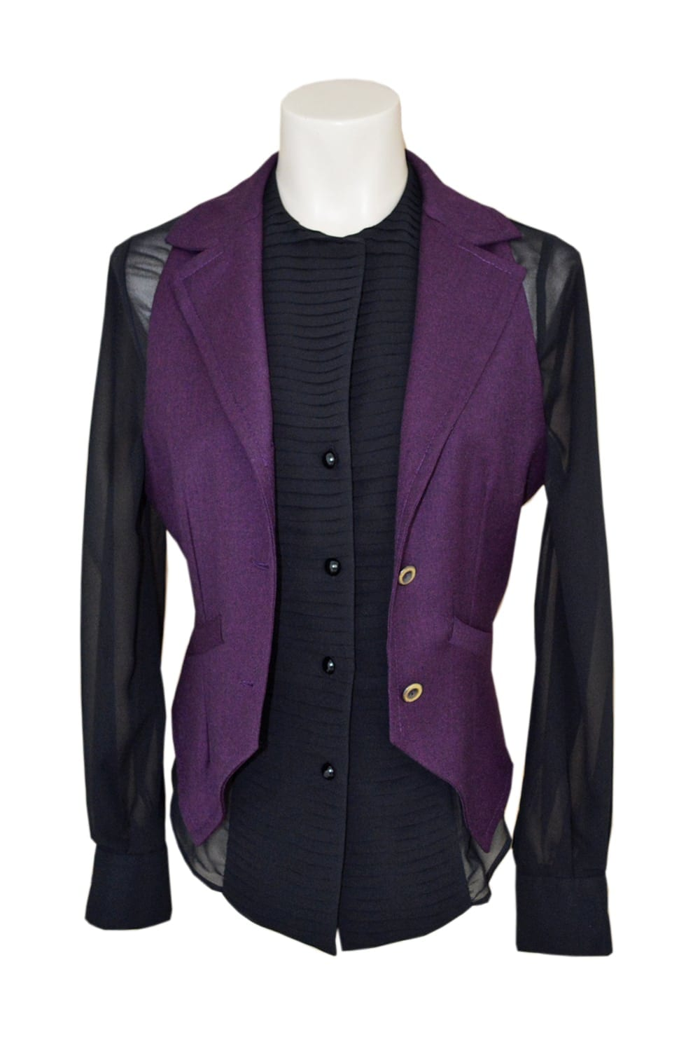 Purple vest without sleeves. Tailored cut with two buttons and side seam pockets. Black lace back.