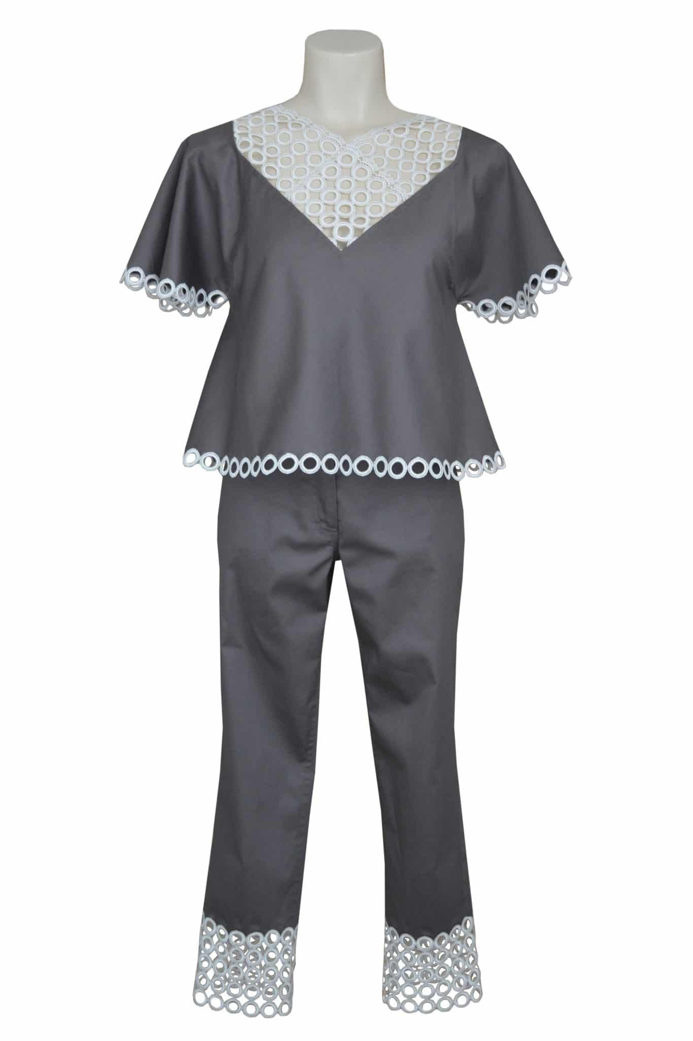 Trendy summer style. Elegant top and pants in cotton and white guipure.