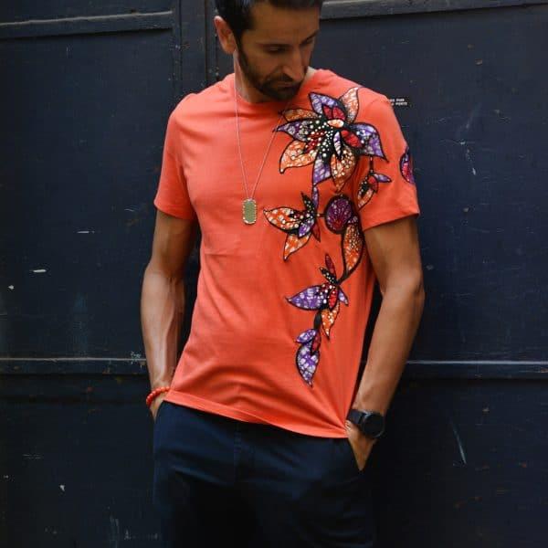 Classic round neck orange t-shirt with Vlisco super wax loincloth inlays.