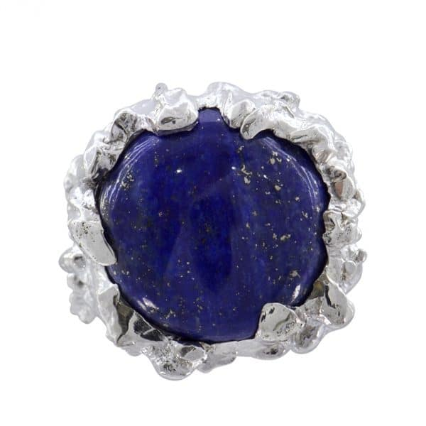 Textured unique silver ring set with a round lapis-lazuli cabochon.