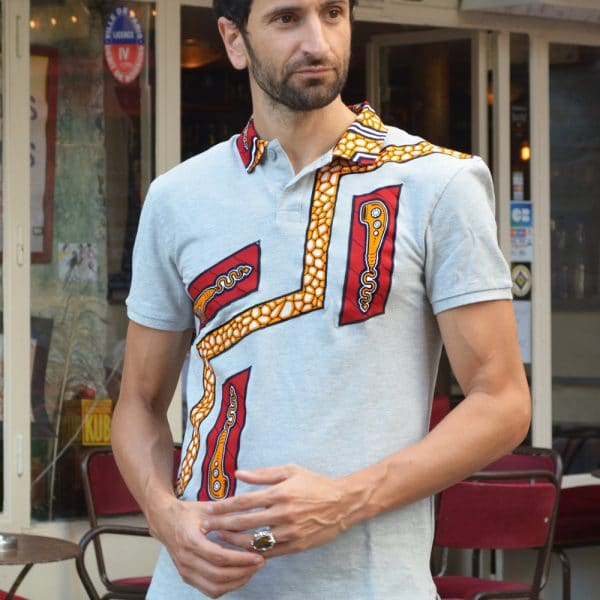 Light gray short-sleeved polo shirt inlaid with Vlisco super wax loincloth.