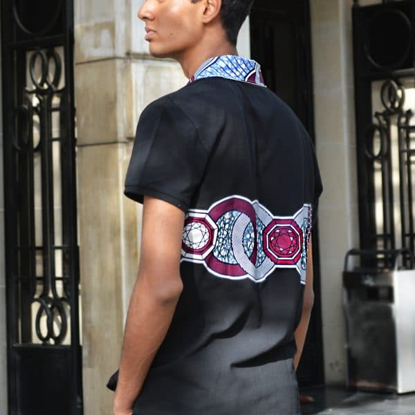 Black short-sleeved polo shirt with inlaid Vlisco super wax loincloth.