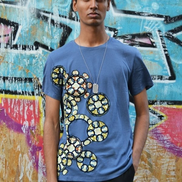 Men's classic round neck blue t-shirt with Vlisco super wax loincloth inlays.