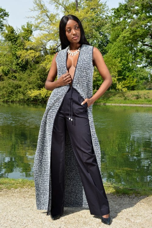 Women fashion summer. Navy blue pants and long coat by the French fashion designer Erik Schaix Paris.