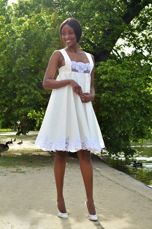 White cocktail dress with lace for special occasion by the French fashion designer Erik Schaix.