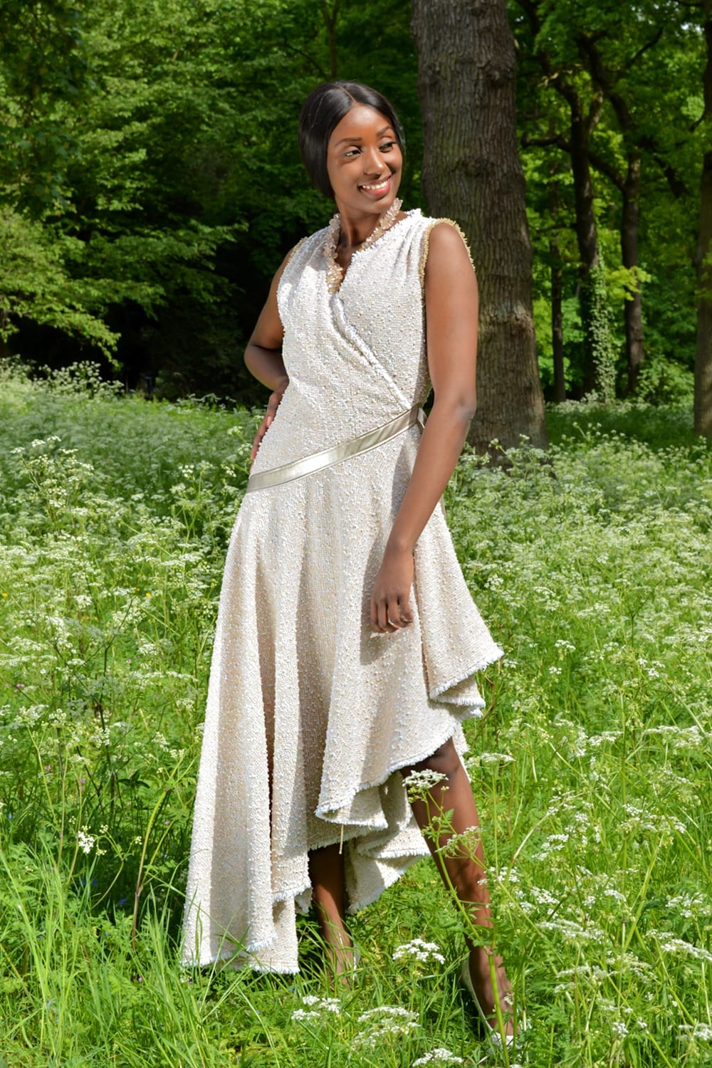 Long pastel dress in beige and pink tweed with asymmetrical cut. TANGO style couture dress by the Parisian stylist Erik Schaix.
