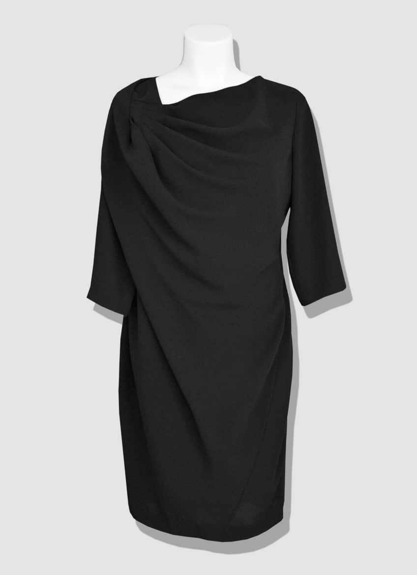 Plus size black dress. Asymmetrical drape on the right shoulder and zip back closure. The little black dress is an iconic piece to wear day and night.