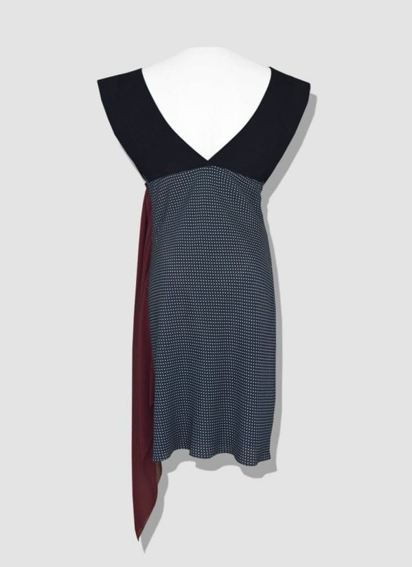 Sleeveless polka dot dress. Jersey bodice with draped skirt and Georgette pan.