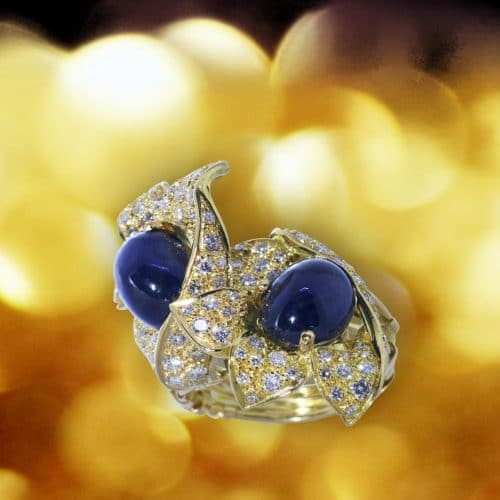 18k yellow gold ring set with diamonds and sapphire hearts.