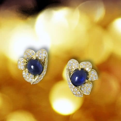 18k yellow gold earrings with sapphire hearts.