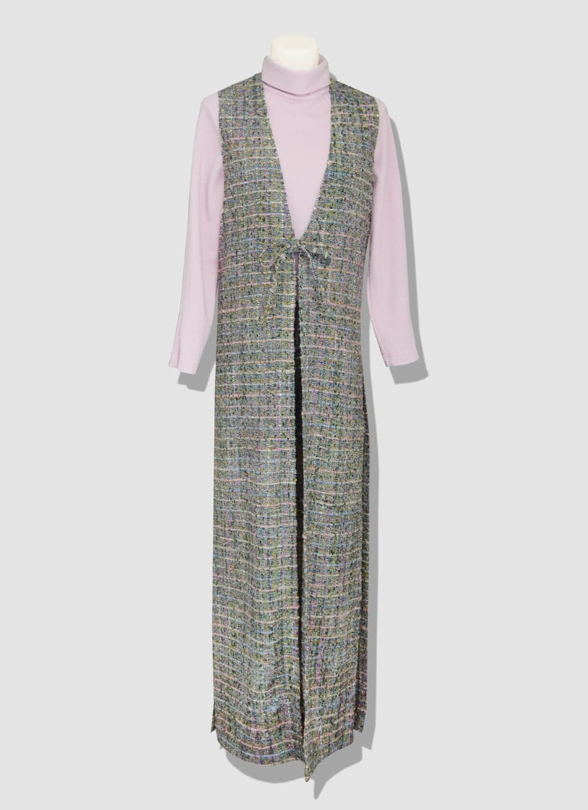 Women's tweed outfit. Colored tweed outfit composed of a shorts, a powder pink turtleneck and a long sleeveless coat.