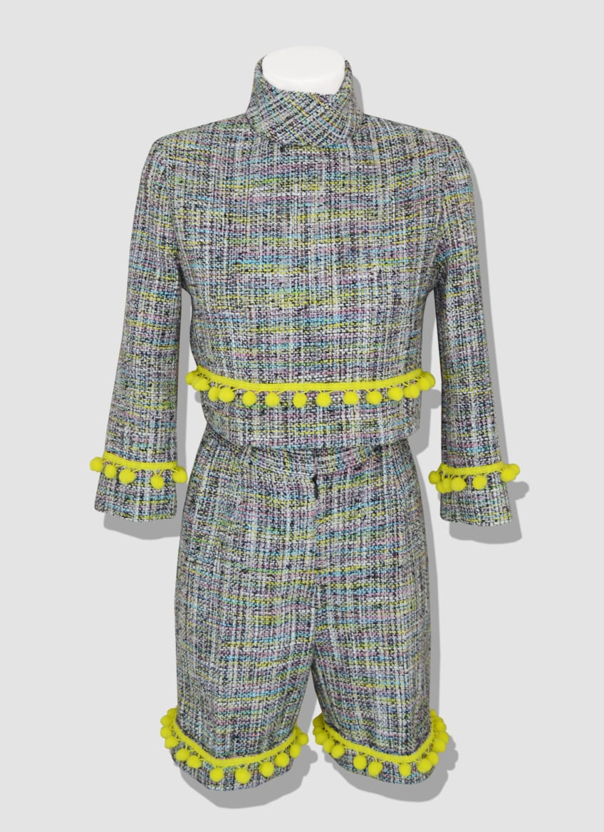 Modern women's suit made of colorful tweed and yellow pompoms. Tweed sweater with a back zip closure. Trendy tweed short with two front pockets. VIENNA outfit designed by the Parisian stylist Erik Schaix.